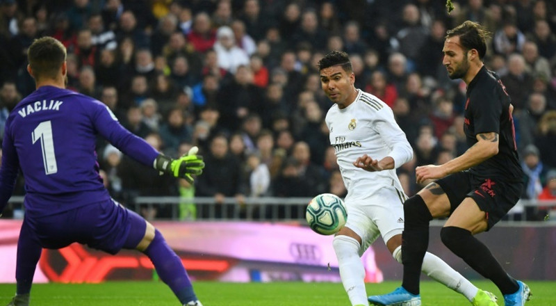 Real make light of absentees to go top with win over Sevilla