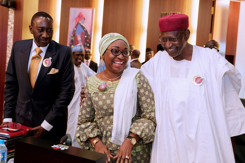 Head of Service, Mrs Winifred Oyo-Ita (left) and Chief of Staff, Abba Kyari (right) reconcile at Federal Executive Council (FEC) meeting after a heated debate days earlier. Looking on is NSA Monguno (far left).