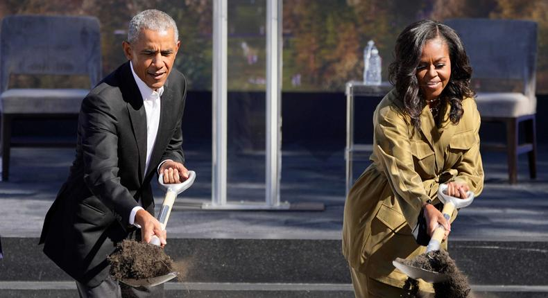 Former President Barack Obama and former first lady Michelle Obama toss shovels of dirt during a groundbreaking ceremony for the Obama Presidential Center in Chicago on September 28, 2021.