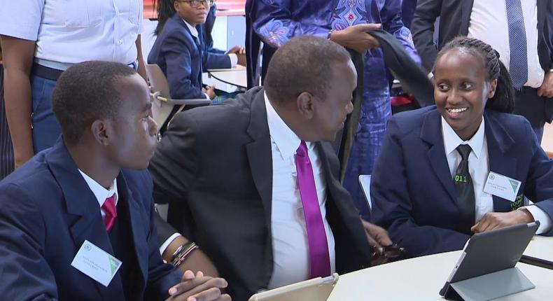 President Uhuru Kenyatta with student at the M-Pesa Foundation. The Tough Question student asked Uhuru during Wednesday's event at Thika