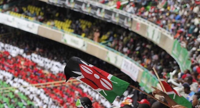 Patriotic Kenyans waving Kenyan flags