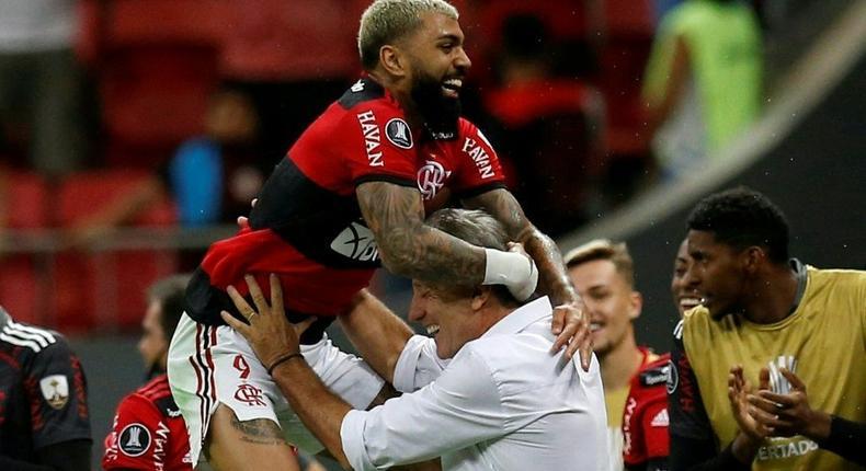 Flamengo's Gabriel Barbosa celebrates with his coach Renato Gaucho after scoring against Olimpia of Paraguay in the Copa Libertadores quarter-finals last month Creator: ADRIANO MACHADO