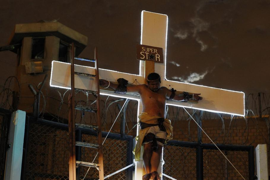 "An inmate depicting Jesus performs the crucifixion scene in the theatre play ""Jesus Christ Superstar"