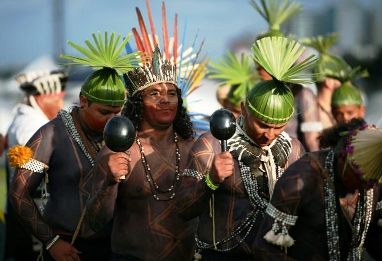 Indigenous people perform a ceremonial ritual