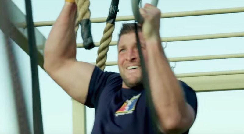Watch Tim Tebow Try to Complete a US Army Assault Course
