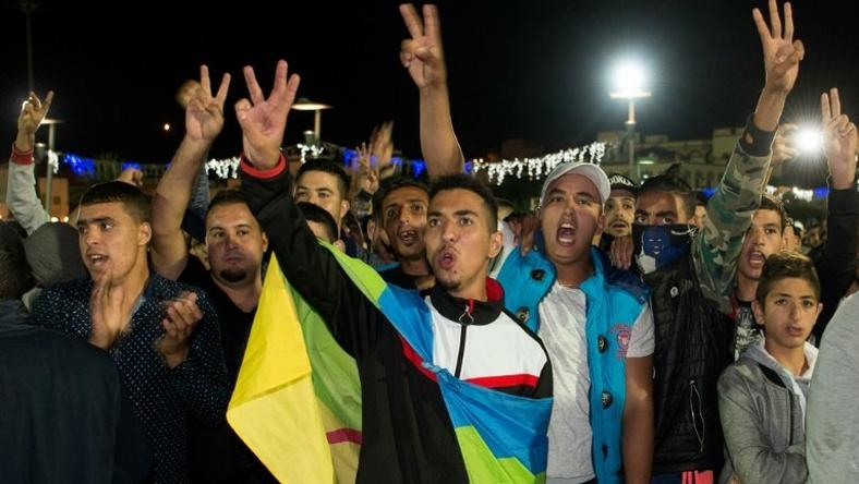 A protester wears the Berber flag in Al Hoceima, northern Morocco on October 30, 2016, following the death of fishmonger Mouhcine Fikri