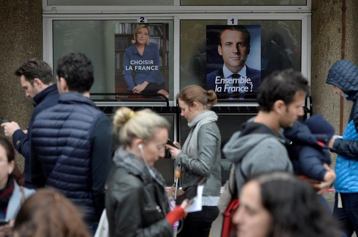 French expats queue outside the Lycee Francais Charles de Gaulle to cast their vote in the second ro