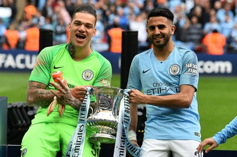 Riyad Mahrez (right) played a key role in Manchester City winning the English domestic treble last season
