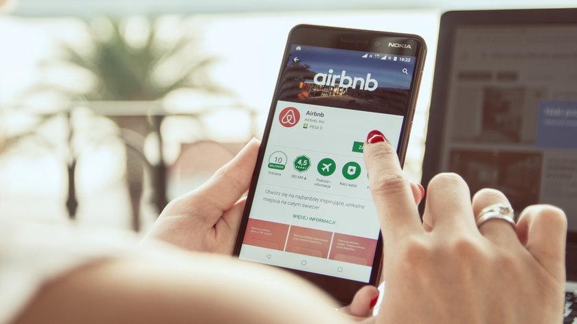 TROGIR, CROATIA - SEPTEMBER 13th, 2018: Woman is installing Airbnb application on Nokia smartphone.