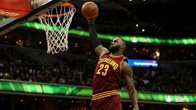 Cavs down Wizards on another milestone night for James