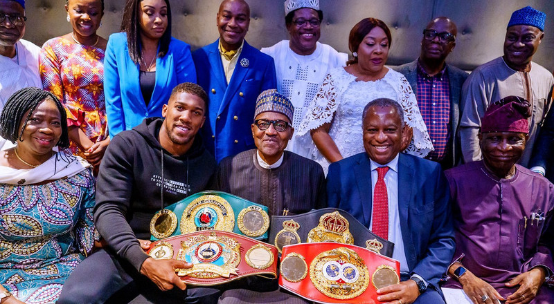 Anthony Joshua says he is proud to be Nigerian as he presents his belts to President Muhammadu Buhari