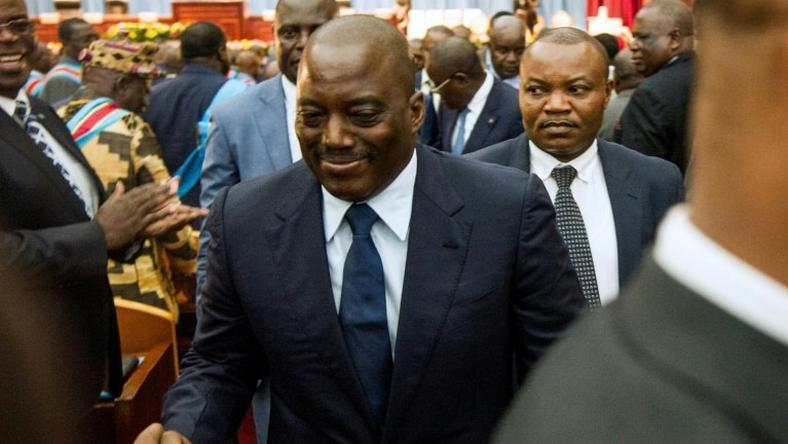 Opponents of Congolese President Joseph Kabila (C) accuse him of delaying the presidential vote in the hope of tweaking the constitution to extend the Kabila family's hold over the nation