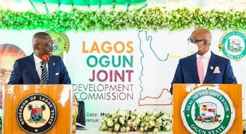 L-R: Lagos State Governor, Mr Babajide Sanwo-Olu and his Ogun State counterpart, Prince Dapo Abiodun during the signing of Memorandum of Understanding on Lagos-Ogun Joint Development Commission at Abeokuta, Ogun State on Monday, May 24, 2021.