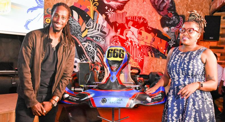 JBLESSING (RACER) WITH KBL HEAD OF SPIRITS GRACE NSHEMEIRE GWAKU DURING THE LAUNCH OF JOHNNIE WALKER FORMULA 1 VR & GP KARTING CHAMPIONSHIPS LAUNCH IN NAIROBI (1)
