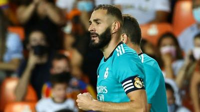 Benzema strikes again as Real Madrid stun Valencia with late double