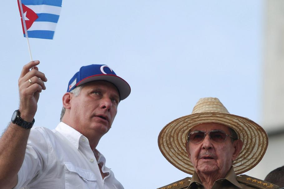 Cuba's First Secretary of the Communist Party and former President Raul Castro speaks to Cuba's Pres