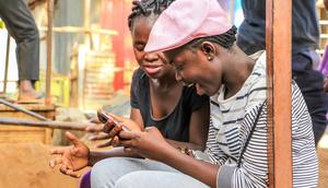 Kenyans using a phone