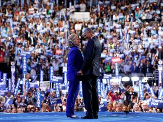 Clinton joins Obama onstage after his remarks on the third night of the Democratic National Conventi