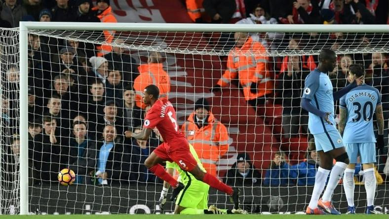 Liverpool's Dutch midfielder Georginio Wijnaldum (C) celebrates after scoring the opening goal of the English Premier League football match between Liverpool and Manchester City at Anfield in Liverpool, north west England on December 31, 2016