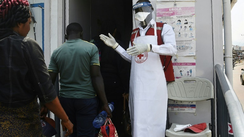 Health official screens travellers crossing Uganda's border to prevent Ebola outbreak