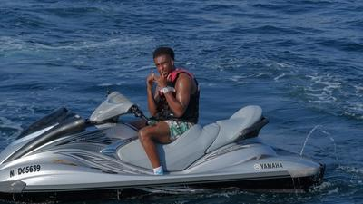 Super Eagles star Alex Iwobi hits the jet ski while on holidays in Cannes