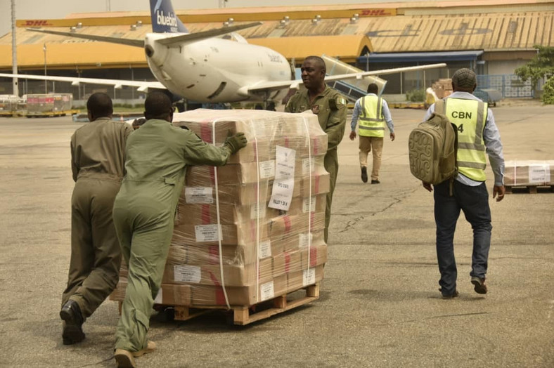 CBN official and Air Force personnel working on electoral materials