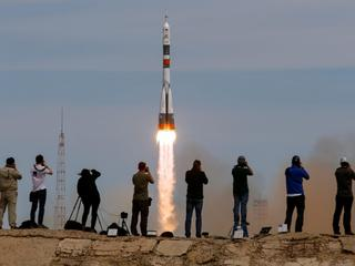 Photographers take pictures as Soyuz MS-04 spacecraft carrying the crew of Fischer of the U.S. and Yurchikhin of Russia as it blasts off to ISS from the launchpad at the Baikonur Cosmodrome
