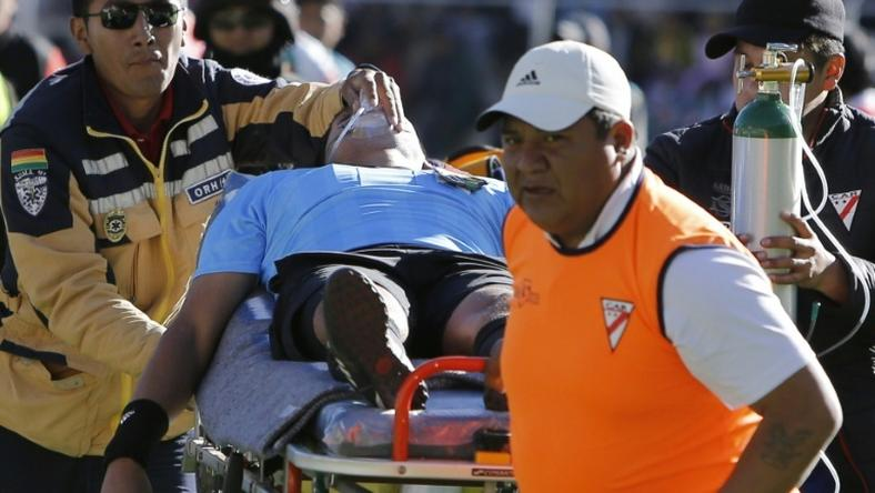 Bolivian referee Victor Hugo Hurtado is taken away on a stretcher during Bolivia's first division football match between Always Ready and Oriente Petrolero at the Municipal Stadium in El Alto, Bolivia on May 19, 2019
