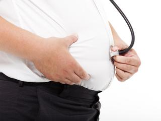 fat Man holding stethoscope for medical exam concept