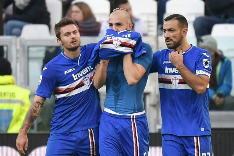 Sampdoria forward Fabio Quagliarella (R) converted a penalty to go top of the Serie A scorers chart with 20 goals