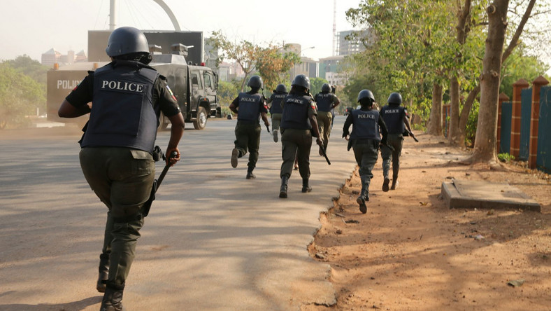 Nigerian Police officers on the run (Illustraton - NewDawnNigeria)