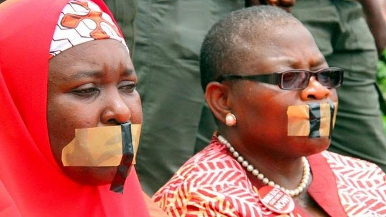 Oby Ezekwesili (R) with another member of the Bring Back Our Girls (BBOG) group during a silent protest on August 30, 2016.