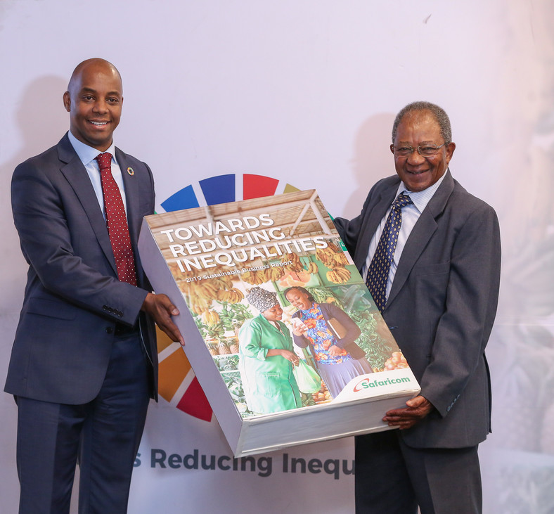 Chief Corporate Affairs Officer, Safaricom PLC, Steve Chege, (L), and Chairman atSafaricom PLC, Nicholas Ng'ang'a, as they unveil Safaricom's 8 th Sustainable Reportat MJC.