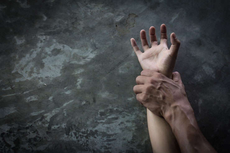 stock-photo-man-s-hand-holding-a-woman-hand-sexual-abuse-and-rape-concept-anti-trafficking-and-stopping-1140973304