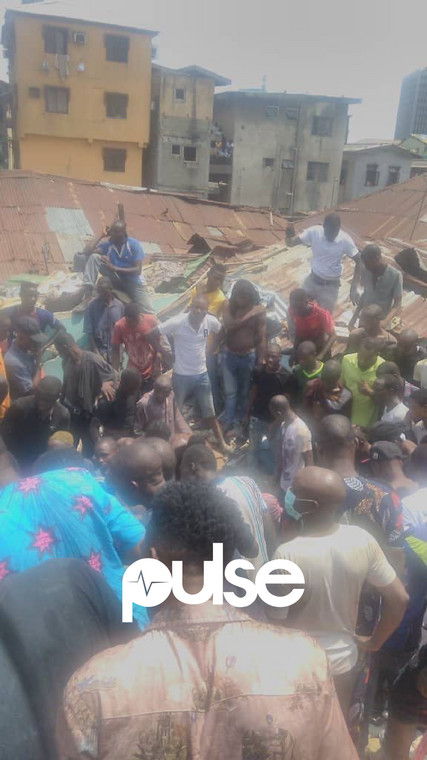 Local residents at the scene of the collapsed building (Pulse)