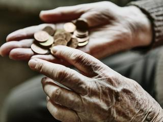 Senior woman's hands with coins