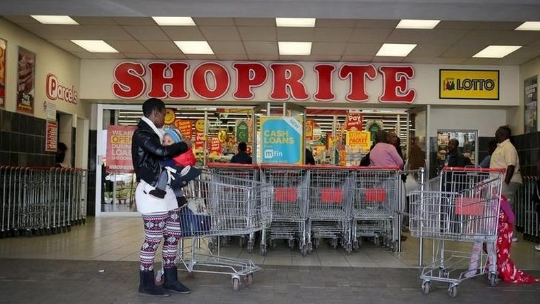 A shopper is seen outside a Shoprite store in Johannesburg July 7, 2015. REUTERS/Siphiwe Sibeko