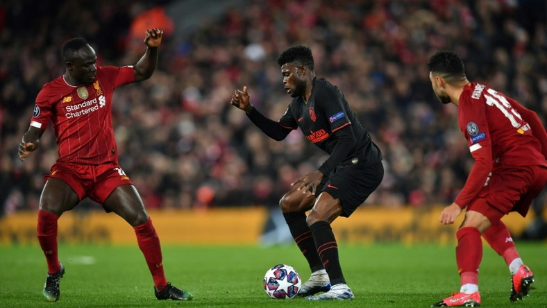 Senegalese Sadio Mane (L) of Liverpool and Ghanaian  Thomas Partey (C) of Atletico Madrid are among the stars set to light up the 2021 Africa Cup of Nations in Cameroon