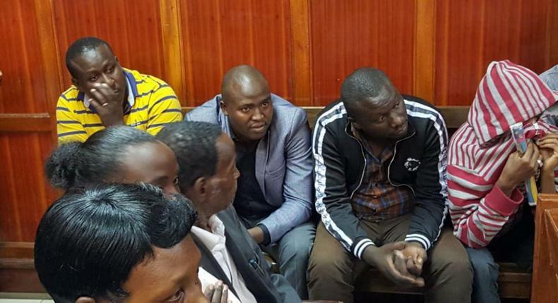 Suspects who conned Sameer Africa Chairman Naushad Merali through impersonating President Uhuru Kenyatta during a court hearing (Twitter)