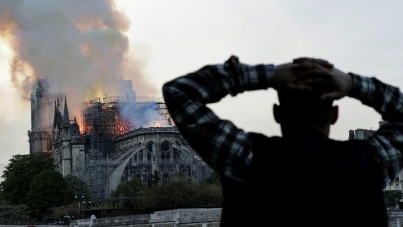 Anxious passersby watched the landmark cathedral burn