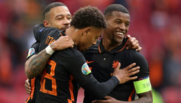 Georginio Wijnaldum (R) celebrates with Memphis Depay and Donyell Malen after scoring his second goal and the Netherlands' third against North Macedonia Creator: Kenzo Tribouillard