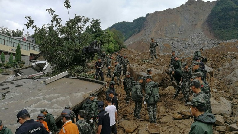 Chinese rescue workers at the scene of the landslide in Guizhou province