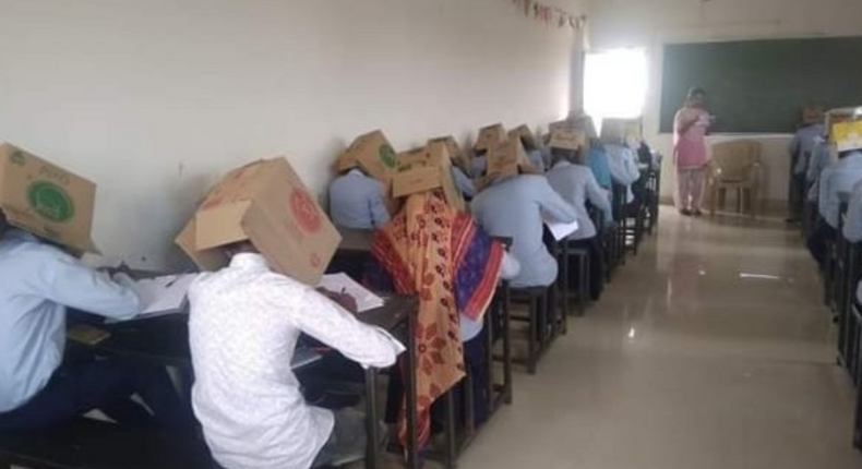 School comes under fire after making students wear boxes to curb cheating. (Twitter)