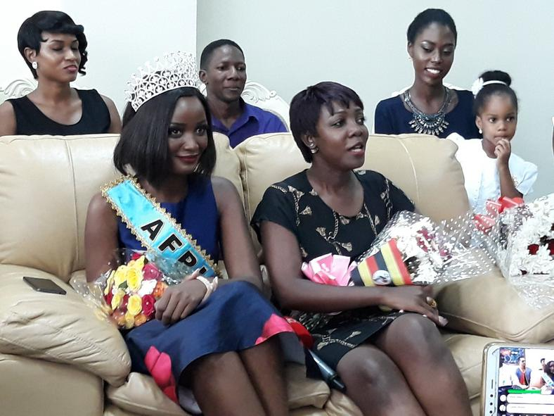 Miss Uganda Abenakyo sitting next toMiss Uganda Foundation CEO Brenda Nanyonjo shortly after arriving in Uganda (Chano8)
