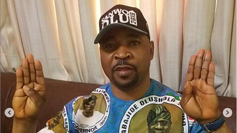 MC Oluomo does the 4+4 sign for Buhari's re-election (Lailas Blog)