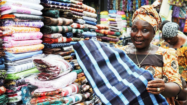 An Africa woman selling fabrics in a market