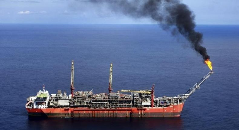A ship loads crude oil, which remains Nigeria's major trading export, at Bonga off-shore oil field outside Lagos, file photo. REUTERS/Akintunde Akinleye