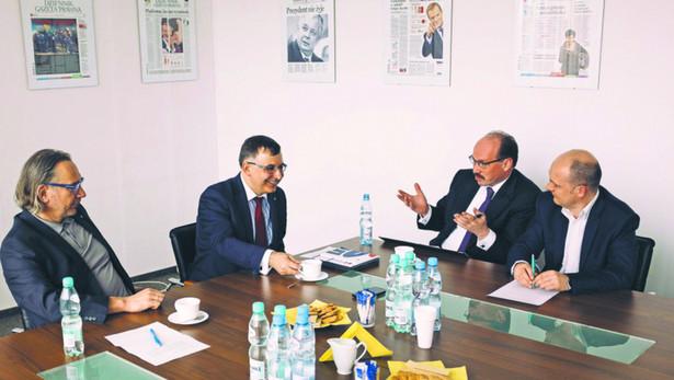 Cezary Stypułkowski, prezes mBanku, Zbi gniew Jagiełło, szef PKO Banku Polskiego, Łukasz Bystrzyński, partner w firmie doradczej PwC, i Łukasz Wilkowicz, dziennikarz DGP