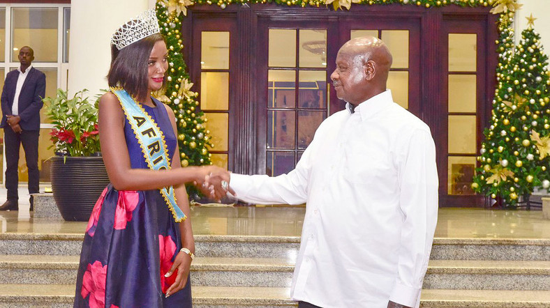 Ugandan President Yoweri Museveni with Miss World Africa Quiin Abenakyo at State House, Entebbe on December 19, 2018.
