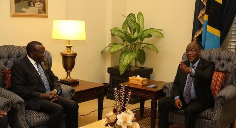 Tanzanian President John Magufuli (right) during talks with Health CS Cleopa Mailu in Tanzania.